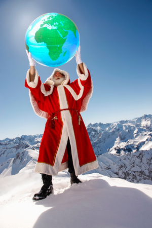 santa claus holding up a globe